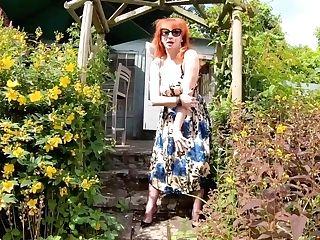 Huge-boobed Stunner Crimson Xxx Thumbs Herself In The Garden