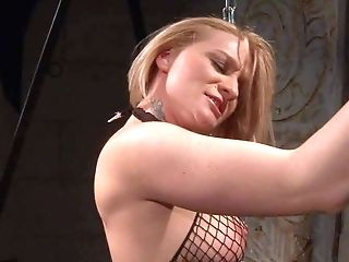Arousing And Provocative Blonde Bitch With Back Tattoo In Fishnet